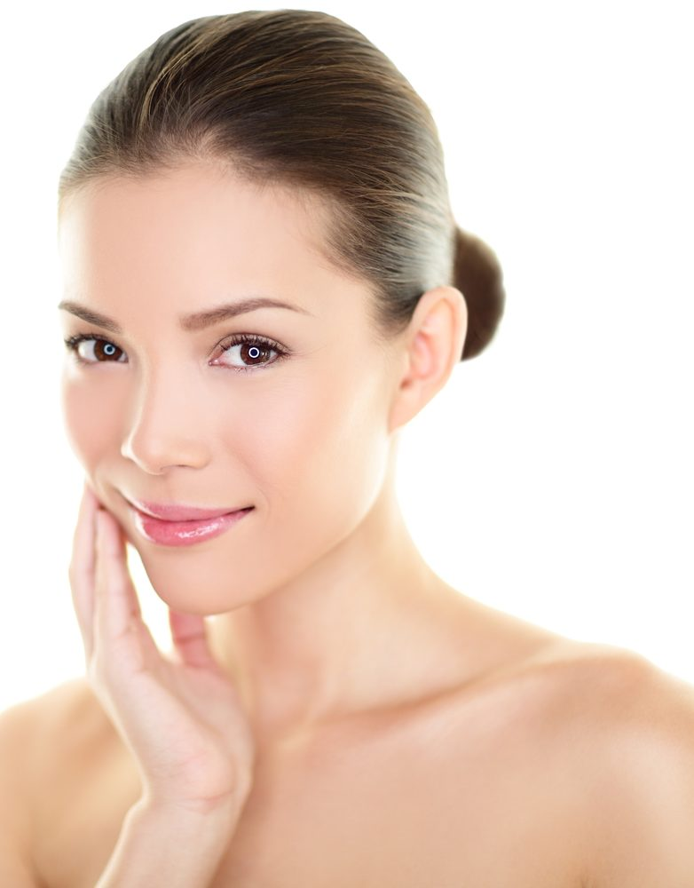 Asian beauty skincare woman touching perfect skin on face. Beautiful wellness beauty care and spa concept with multi-ethnic Chinese Asian / Caucasian girl with healthy glowing skin isolated on white.