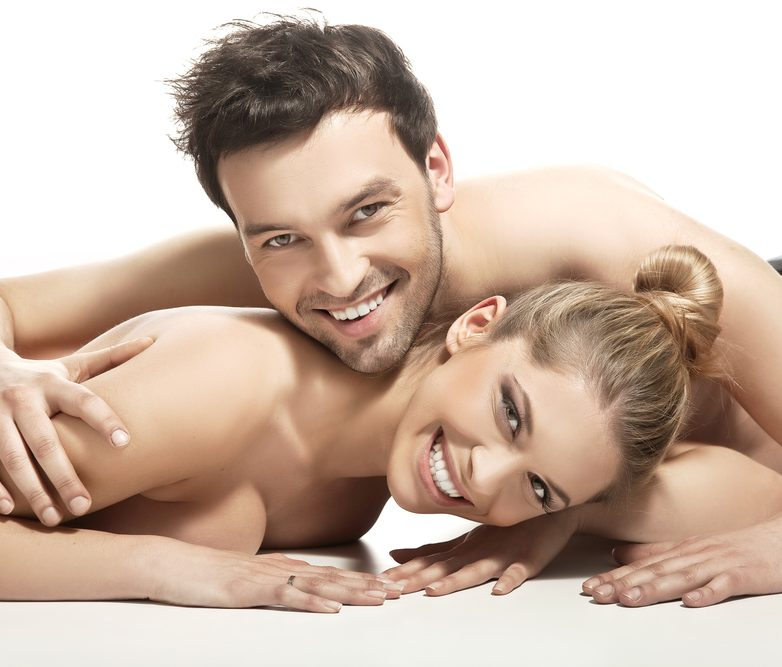 Beautiful young couple lying on the bed